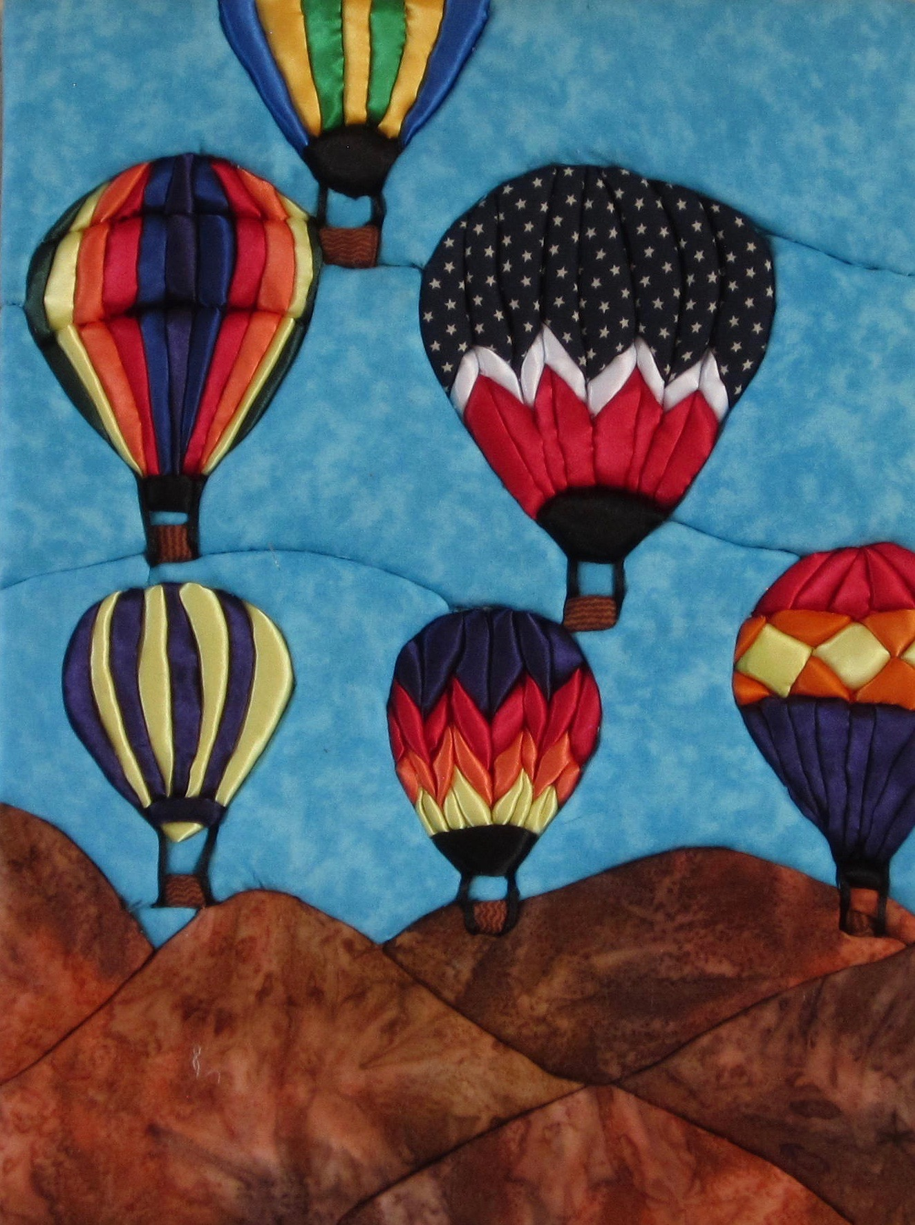 E. Cristina Diaz-Arntzen: Albuquerque Balloon Festival triptych